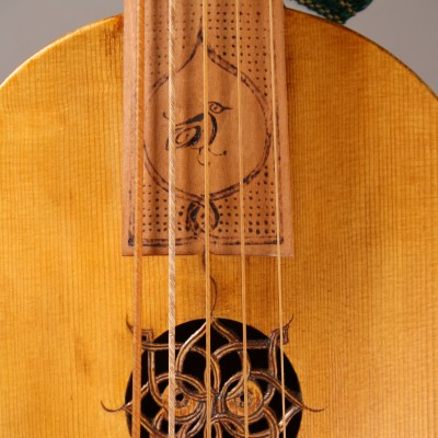 Rose on Viella Strix after Iberian painting 1439. Alder carved back and sides, no soundpost.